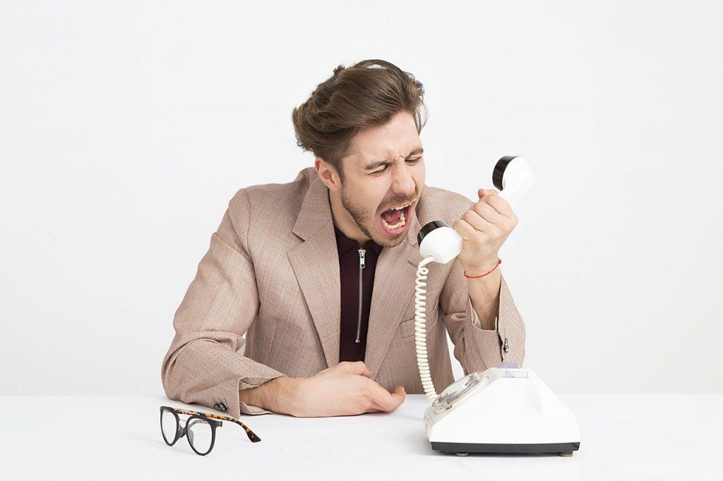 Mad man shouting at the phone